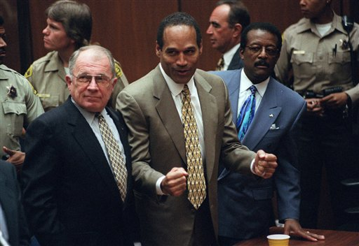 This Oct. 3, 1995 file photo shows O.J. Simpson, center, with defense attorneys F. Lee Bailey, left, and Johnnie Cochran after Simpson was found not guilty of murdering his ex-wife Nicole Brown Simpson and her friend Ron Goldman at the Criminal Courts Building in Los Angeles. Sony Electronics and the Nielsen television research company collaborated on a survey ranking TV's most memorable moments. Other TV events include, the Sept. 11 attacks in 2001, Hurricane Katrina in 2005, the Challenger space shuttle explosion in 1986 and the death of Osama bin Laden in 2011. (AP Photo/Myung J. Chun, file)
