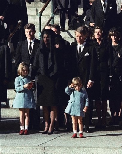 This Nov. 25, 1963 file photo shows three-year-old John F. Kennedy Jr. saluting his father's casket in Washington on Nov. 25, 1963, three days after the president was assassinated in Dallas. Widow Jacqueline Kennedy, center, and daughter Caroline Kennedy are accompanied by the late president's brothers Sen. Edward Kennedy, left, and Attorney General Robert Kennedy. Sony Electronics and the Nielsen television research company collaborated on a survey ranking TV's most memorable moments. Other TV events include, the Sept. 11 attacks in 2001, Hurricane Katrina in 2005, the O.J. Simpson murder trial verdict in 1995 and the death of Osama bin Laden in 2011. (AP Photo, file)