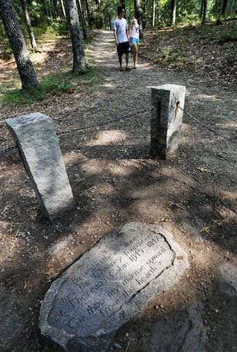 A stone inscription marks the actual site of Henry David Thoreau's cabin on the shores of Walden Pond in Concord, Mass. Members of the Thoreau Society gathered in Concord today for the third day of their annual gathering in honor of the naturalist and author.