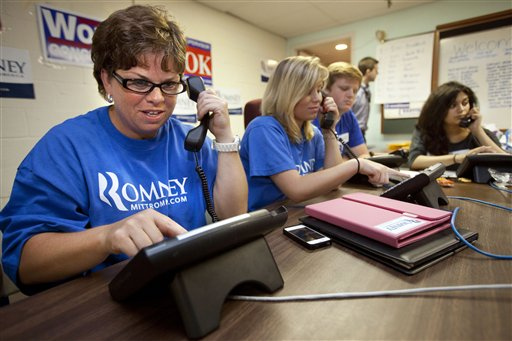In this photo taken June 29, 2012, Karen Chew, left, of Washington, and fellow volunteers make phone calls for the Romney campaign at a Romney Victory Office in Fairfaix, Va. where she says she puts in about a dozen hours a week but wishes she could put in more time. Call them passionate, idealistic, earnest, even a tad naive: The volunteers helping to power the Obama and Romney campaigns are outliers at a time when polls show record low public satisfaction with government and a growing belief that Washington isn�t on their side. While motivated by opposing goals, the Obama and Romney volunteers share at least one key trait: an abiding faith in the political process and a belief that it still matters who occupies the White House. (AP Photo/Jacquelyn Martin)