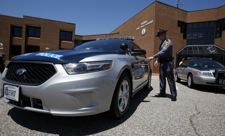 An officer in Virginia checks out a new Ford Taurus police cruiser like the ones that will be used by Maine State Police.