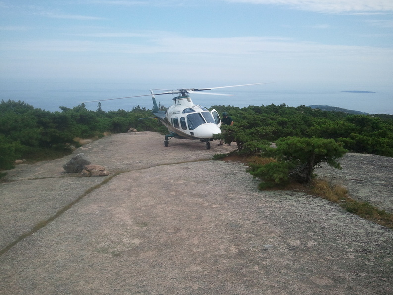 A helicopter from LifeFlight of Maine landed on a sloped, open ledge on Champlain Mountain in Acadia National Park in order to evacuate an injured hiker Saturday.