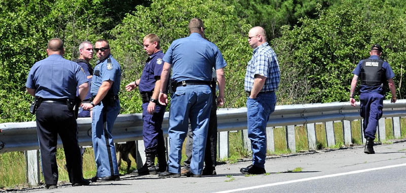 Law enforcement officers from several agencies prepare to spread out along Route 150 in Skowhegan in an effort to capture escaped Somerset County Jail inmate Dylan Perkins on Monday.