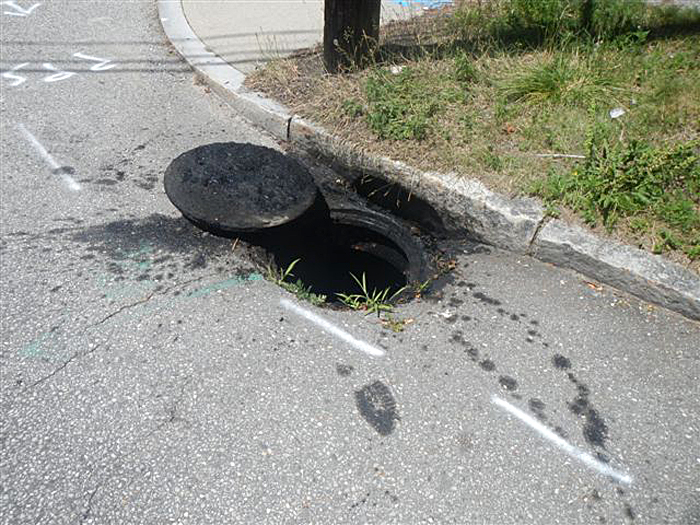 Waste oil residue surrounds the stormwater catch basin at Falmouth and St. John streets.