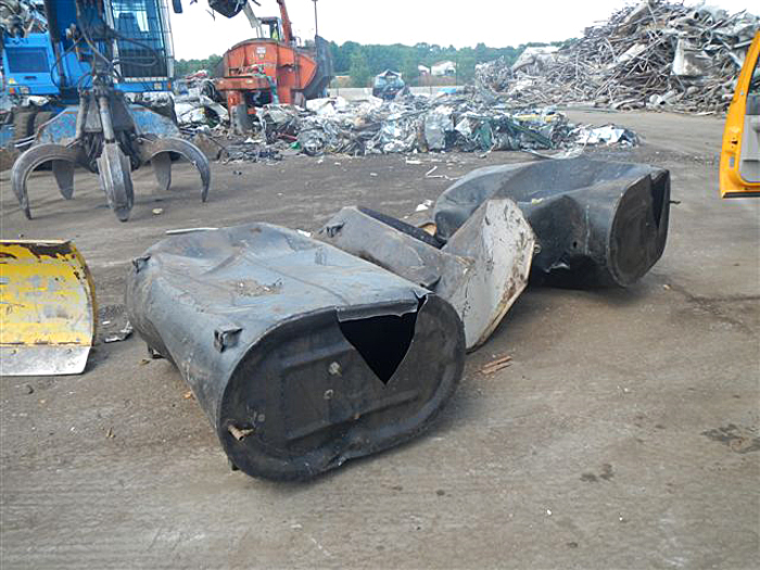Investigators believe these three home heating oil tanks that were delivered by flatbed truck to Schnitzer Steel scrapyard on Riverside Street were the source of the waste oil dumped at Falmouth and St. John streets.