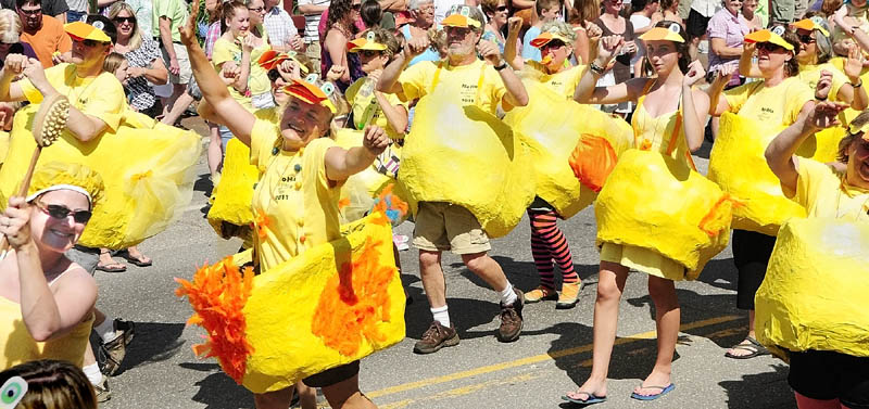 A group of dancing rubber duckies from the NoHa neighborhood group performs in front of the judges' stand during the Old Hallowell Day parade last year. The NoHa group of dancing duckies, and a couple of bathers in towels along with Bert and Ernie, won the Grand Marshall award as best overall entry.
