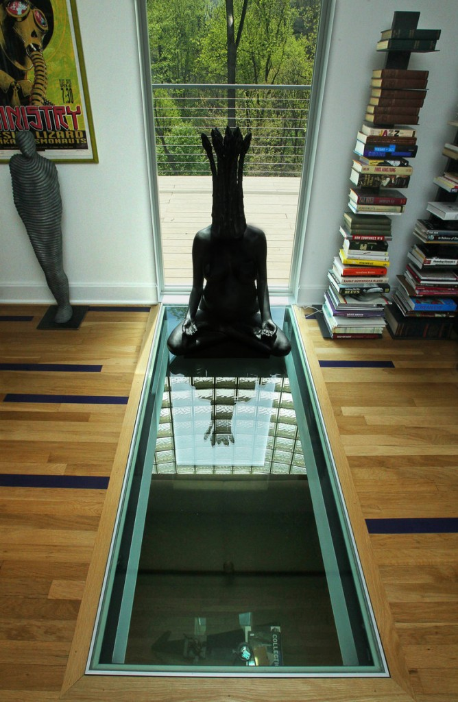 An upstairs view of the structural glass floor that interior designer Steve Levey installed in an Akron, Ohio, home.