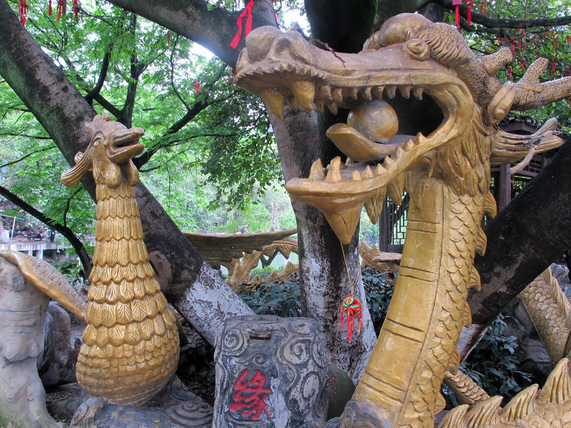 "A serpent greets visitors to a ""wishing tree"" at Elephant Trunk Hill in Guilin."