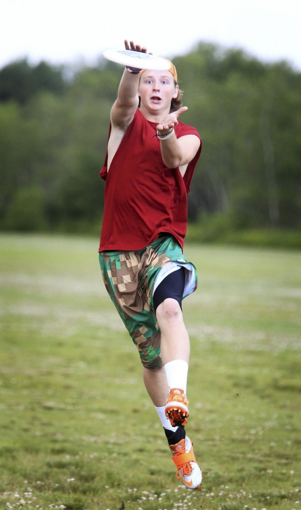 Hudson Carr of Falmouth makes a grab while warming up with Rising Tide before an ultimate Frisbee game at Wainwright Fields in South Portland.