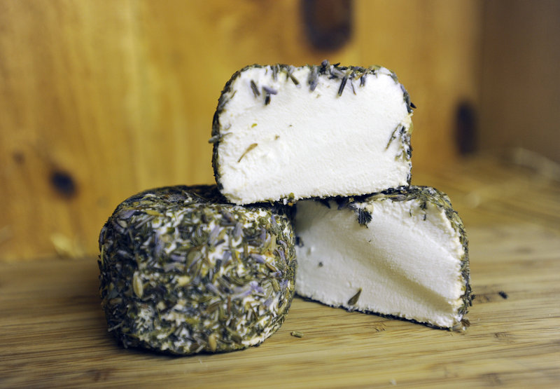 Kennebec Cheesery's goat's milk cheese can be enjoyed plain or rolled in herbes de Provence, as shown here.