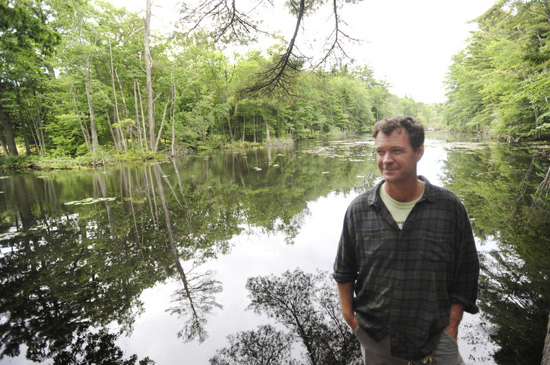 Chris Franklin, executive director of the Cape Elizabeth Land Trust, near a pond on the land that the trust is trying to keep wild.