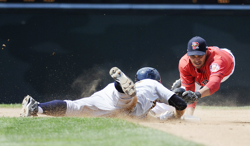 Portland's Ryan Dent dives to second base to try and tag Trenton's David Adams. Adams was safe, though, and the Thunder went on to defeat the Sea Dogs in the 11th.