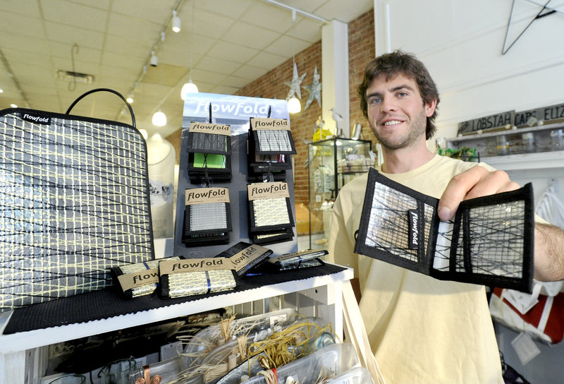 Charles Friedman, 23, is founder of FlowFold wallets and tablet cases, which he displays at Lisa-Marie's Made in Maine store in Portland in this July 2012 file photo.