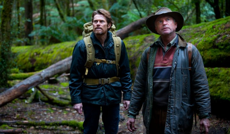 "Willem Dafoe, left, and Sam Neill in ""The Hunter."""
