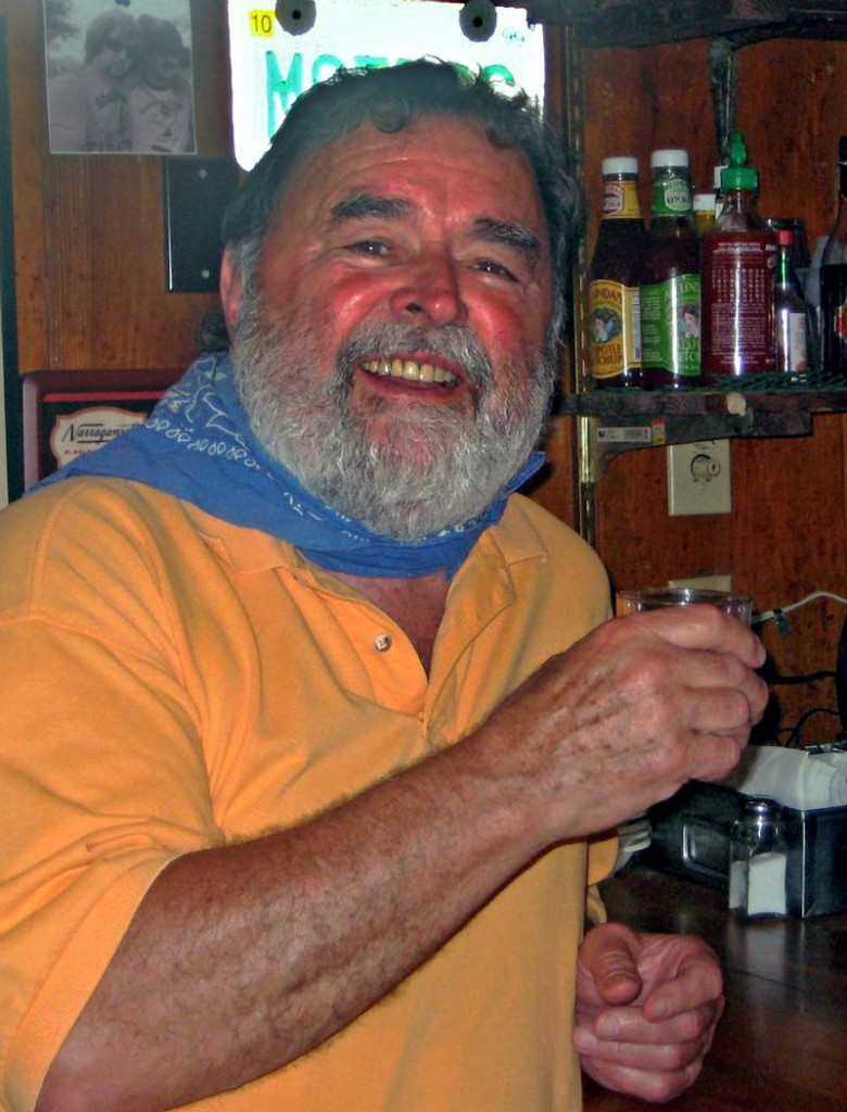 In this photo provided by the Florida Keys News Bureau, Richard Costello poses in his restaurant in Chatham, Mass., on Monday after learning he had won a Facebook-based Virtual