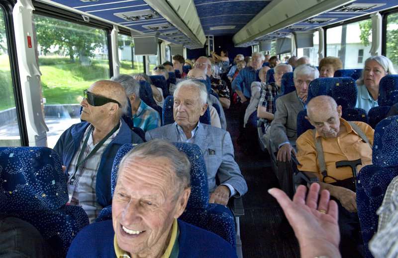 "Former ""Ritchie Boys,"" as students at the military's Camp Ritchie in Maryland were called, take a bus tour of the former site last week with family members and friends."
