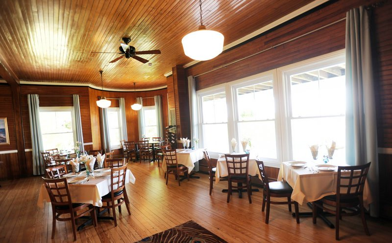 Inside Blue at the Grey Havens Inn, the dining room has dark beadboard walls and a rich wooden bar, ample open floor space, and large windows to take in the gorgeous views.