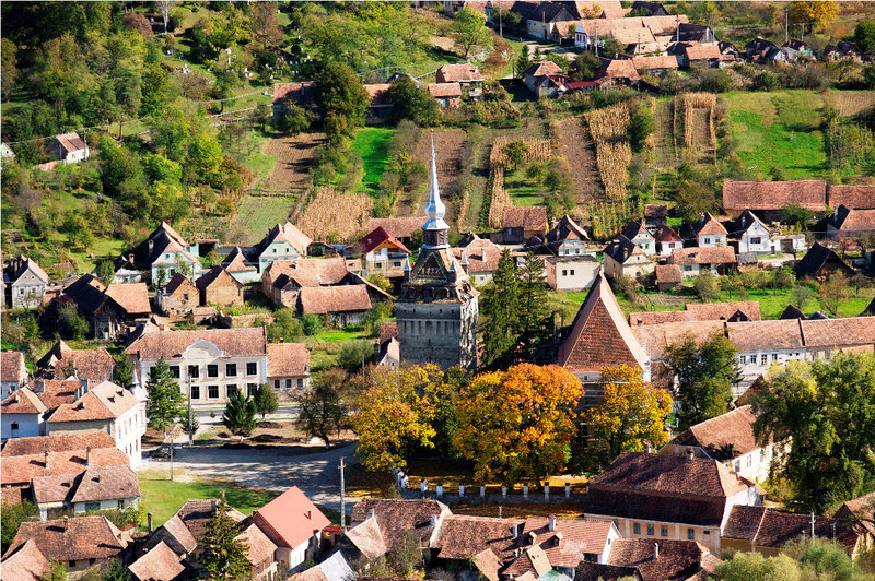 Rooftops, farms and the church form a pretty picture in Saschiz, a town in the Transylvania region of Romania.