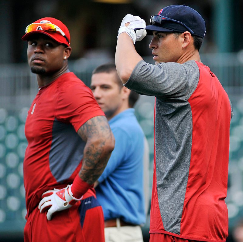 Carl Crawford, left, and Jacoby Ellsbury would be preparing to play the New York Yankees this weekend in a perfect world. Instead they're in New Hampshire, waiting for the call.