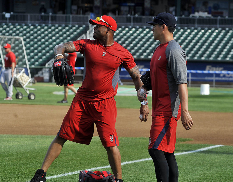 Carl Crawford, left, and Jacoby Ellsbury warm up in the outfield Wednesday as they prepare to play for the Portland Sea Dogs while on rehab assignments from the Red Sox.