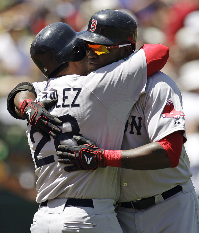 David Ortiz, right, is embraced by Adrian Gonzalez after hitting his 400th career home run Wednesday in Oakland, Calif.