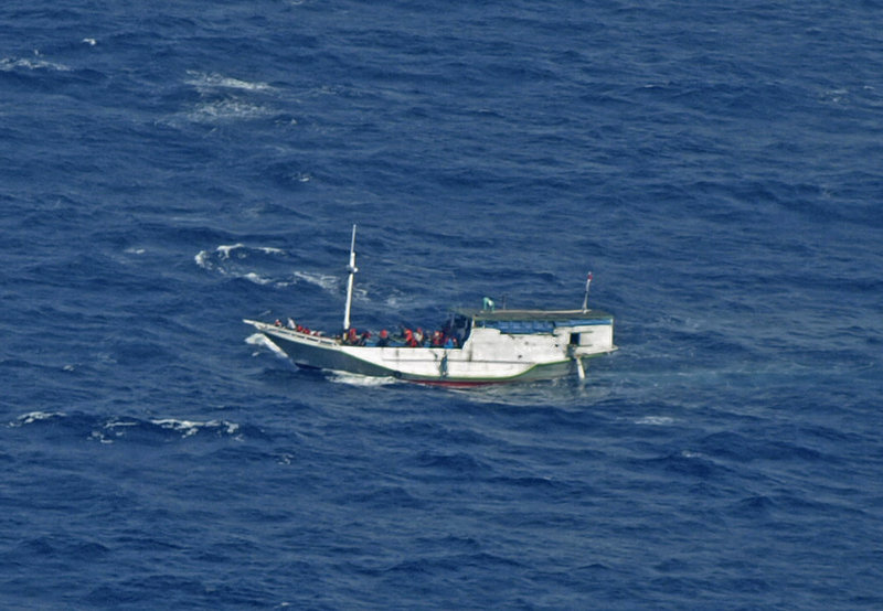 In a photo released by the Indonesian National Search and Rescue Agency, a boat believed to have 162 asylum seekers on board floats on the waters off Christmas Island, Australia, Wednesday.