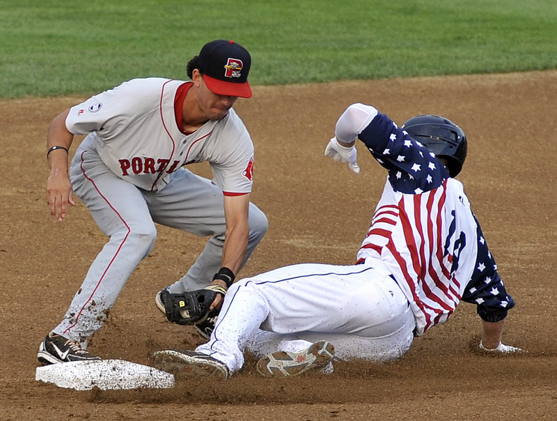 Mark Sobolewski of the New Hampshire Fisher Cats is tagged out by shortstop Derrik Gibson of Portland in the first inning of the Sea Dogs' 11-10 loss in 11 innings Wednesday.