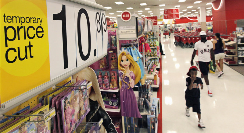 Shoppers take advantage of discounts at a Target store Thursday in Chicago. Americans appear to be spending cautiously a month before the back-to-school season starts.