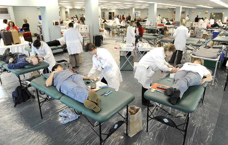 American Red Cross blood drives, like this at the Holiday Inn by the Bay in Portland in 2010, offer an easy way to be a life saver.