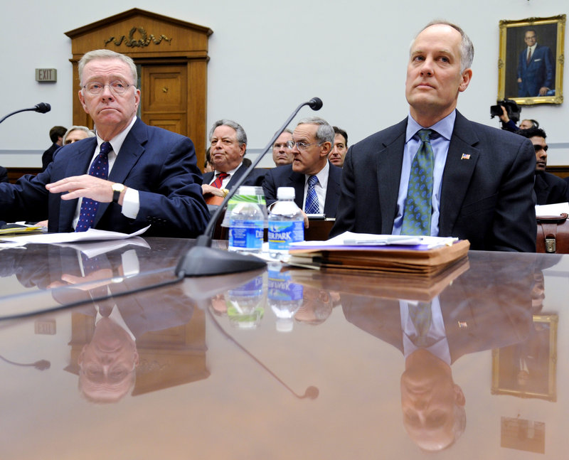 Former Freddie Mac CEO Richard Syron, left, and former Fannie Mae CEO Daniel Mudd wait to testify on Capitol Hill in Washington in December 2008. The former Countrywide Financial Corp., whose subprime loans helped trigger the nation's foreclosure crisis, made hundreds of discount loans to buy influence with members of Congress, congressional staff, top government officials and executives of troubled mortgage giant Fannie Mae, according to a House report.