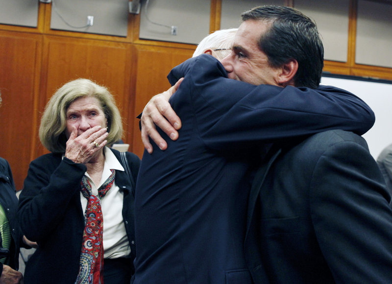 Will Lynch, right, hugs his father, John Lynch, as his mother, Peggy Lynch, watches after he was found not guilty of two felonies Thursday. He was accused of beating an aging priest who Lynch says molested him and his younger brother more than 35 years ago.