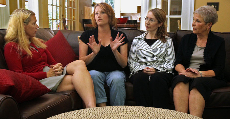 Cancer survivor Lisa Edwards, second from left, talks with parish nurse Cindy Rocco, left; Laurel Lake's community resource coordinator Kristin Keller, third from left; and parish nurse Kaye Collins in Hudson, Ohio. Rocco accompanied Edwards to a doctor's appointment and helped find activities and services aimed at families of cancer sufferers.