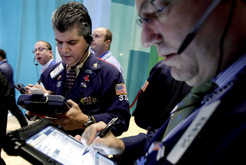 Traders work on the floor of the New York Stock Exchange. Stocks dropped Friday after the government reported that only 80,000 jobs were created in June.