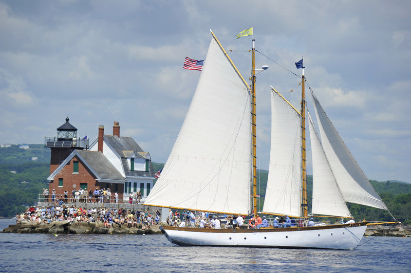 The schooner Olad sails past the Rockland Breakwater Lighthouse on Friday. This year for the first time the event was planned more than a few days ahead.