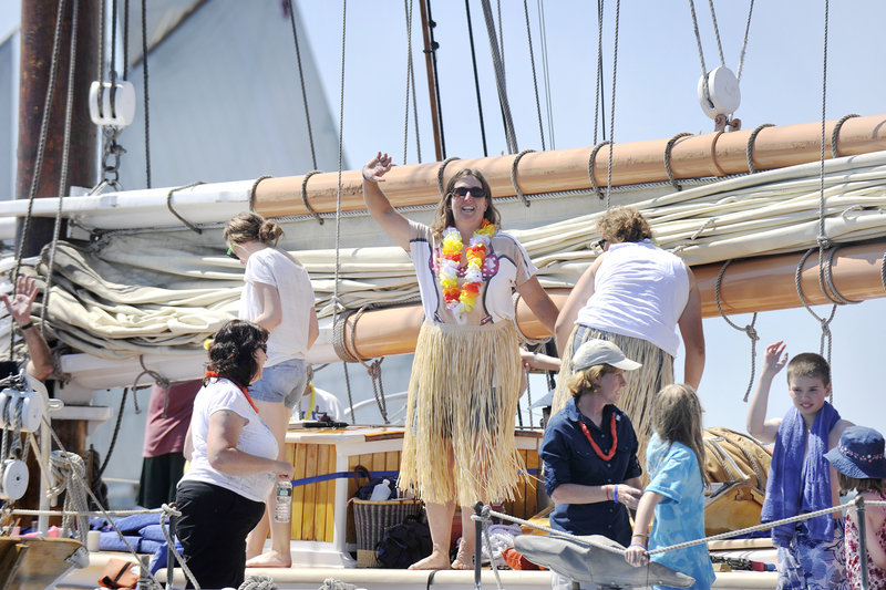 Brenda Thomas, owner and captain of the schooner Isaac H. Evans, waves to other boaters before the sailing started. Her crew included 21 paying guests on a four-day cruise.
