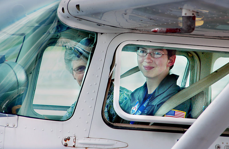 Olivia Fowler, right, finishes her test ride to get her pilot's license on her 17th birthday Friday as a present from her family. Next to her in the cockpit is Mary Build, an examiner from the Federal Aviation Administration.