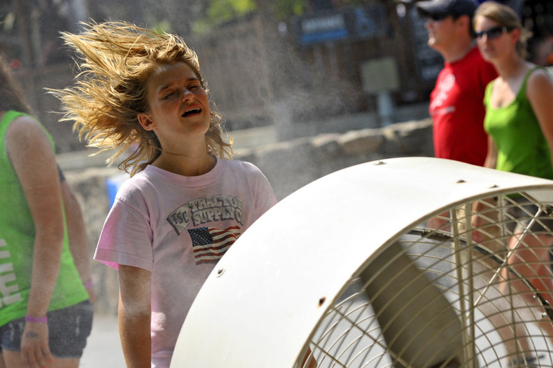 Daisy Zuscar, 12, of Clamore, Okla., cools off at Knoebels Amusement Resort in Elysburg, Pa., Friday.