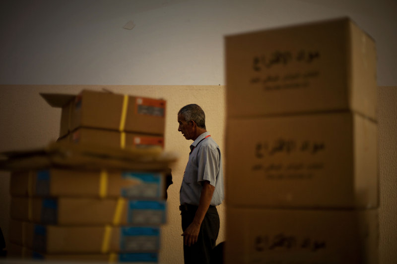 An electoral official prepares a polling station for today's elections in Tripoli, Libya, on Friday. The Libyan National Assembly vote will be the first free elections since 1969.