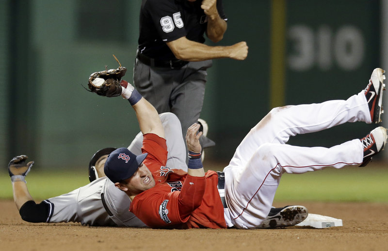 Nick Punto of the Boston Red Sox holds onto the ball Friday night after tagging out Eric Chavez of the New York Yankees, who was attempting to stretch a single to a double in the sixth inning at Fenway Park. The Yankees opened the four-game series with a 10-8 victory.