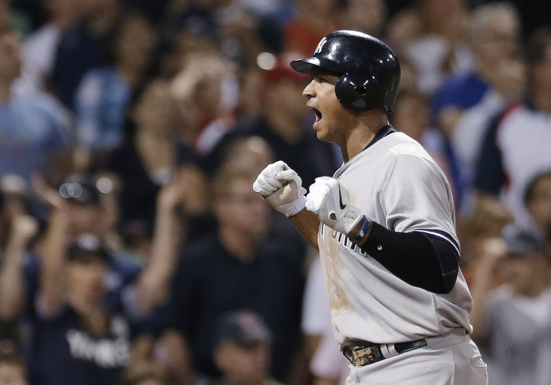 Alex Rodriguez of the Yankees displays his emotion after scoring on Mark Teixeira's triple in the seventh inning that gave New York the lead for good.