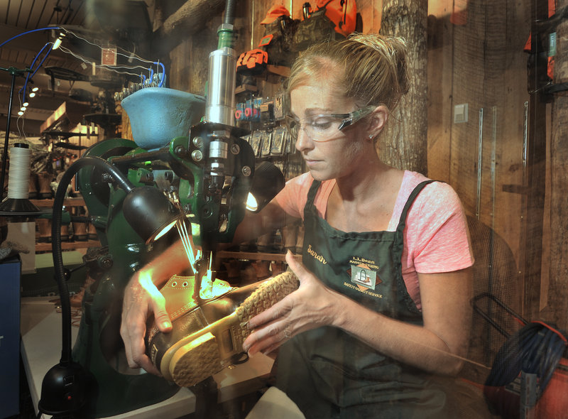 Sarah Davis, an employee of L.L. Bean, demonstrates how to stitch the store's famous Bean boot at the company's retail store in Freeport during Bean's 100th anniversary celebration Saturday.