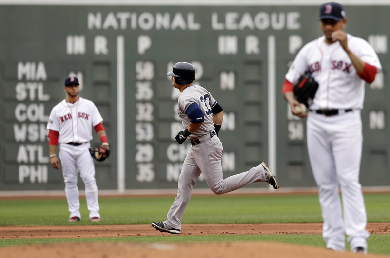 Nick Swisher of the New York Yankees rounds the bases on his three-run homer Saturday against Franklin Morales of the Boston Red Sox in the first inning of the Yankees' 6-1 victory.