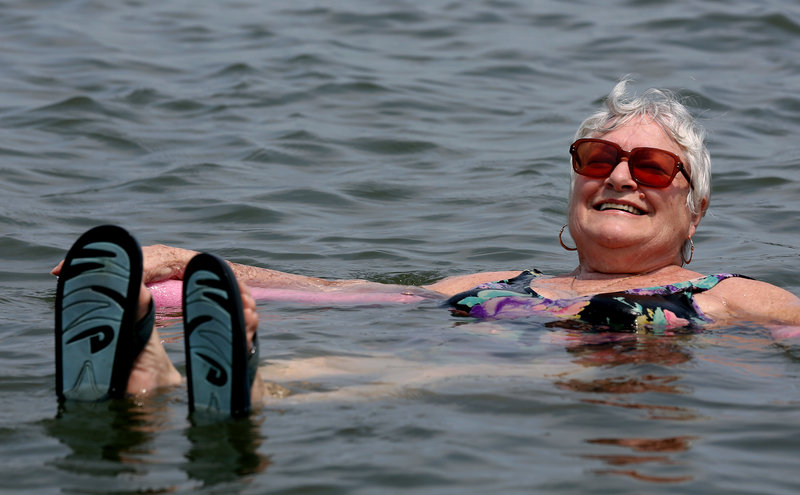 Lillian Mariscalo of Oyster Bay, N.Y., keeps cool on Long Island's North Shore on Saturday.