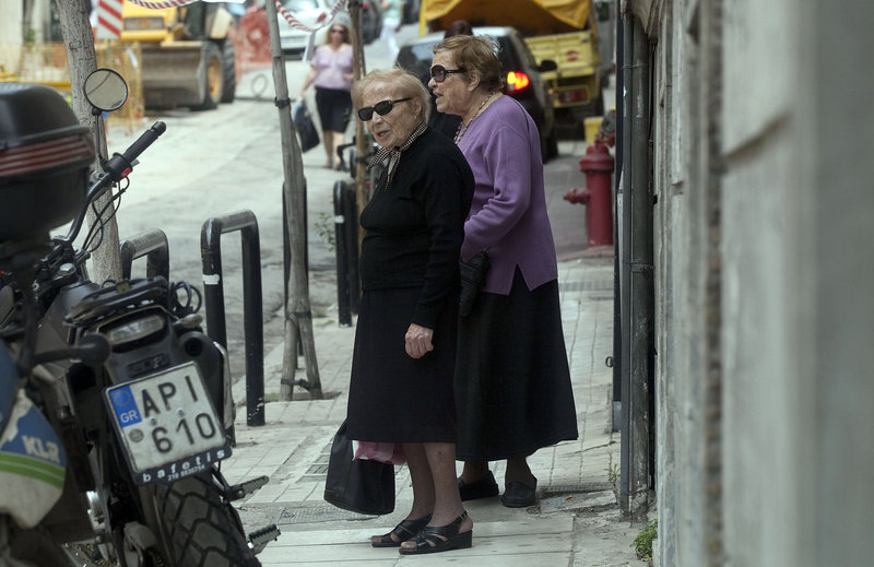 Elderly women walk on a residential street in Athens. The proportion of people age 65 or older in Greece will climb to 26.7 percent in 20 years, complicating government efforts to bring pension and health-care liabilities in line with taxes.
