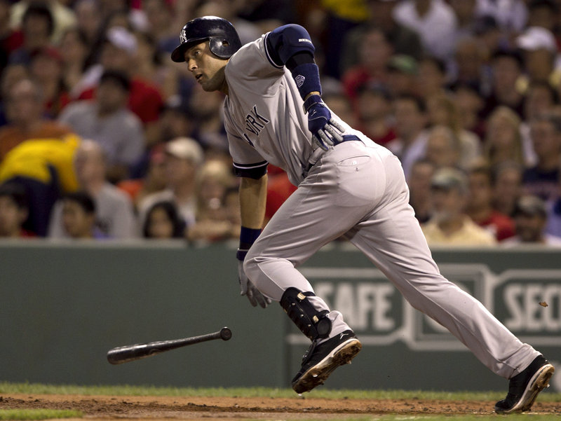 Derek Jeter singles in the second inning Sunday night against Boston's Jon Lester at Fenway Park. Jeter also had a hit in the first inning as the Yankees grabbed a 2-0 lead.