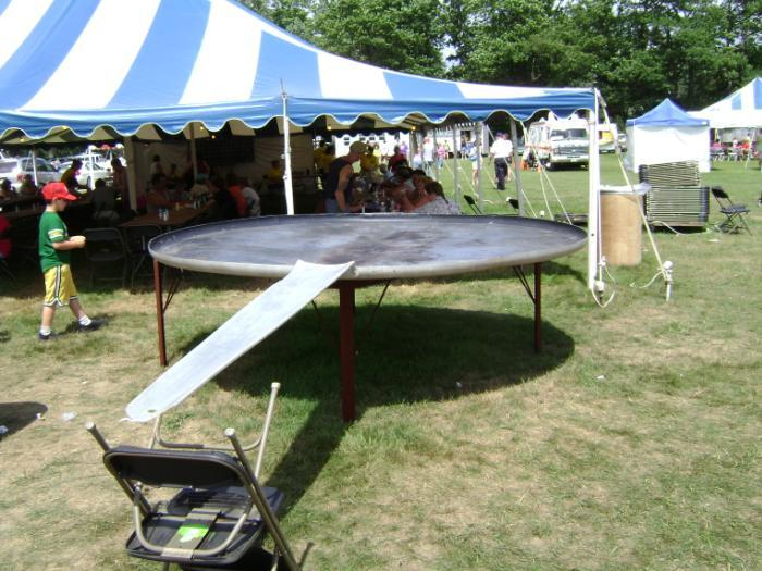 The festival's giant frying pan, made in 1973, is 10 feet in diameter and weighs 300 pounds.