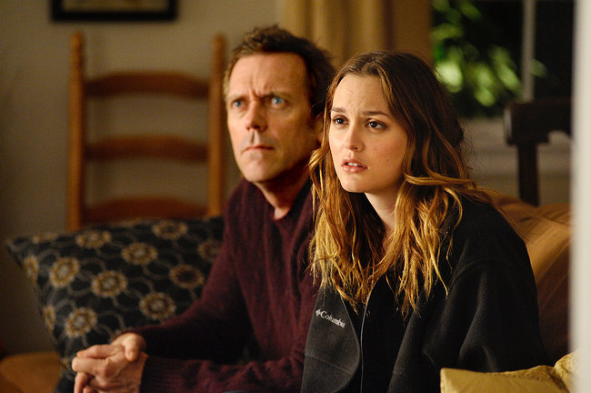 "Hugh Laurie and Leighton Meester in ""The Oranges."""