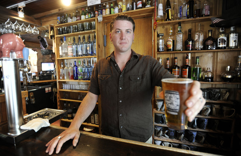 Nat Croteau of Bray's Brewpub in Naples with a glass of the brewery's 1492 Summer Ale.