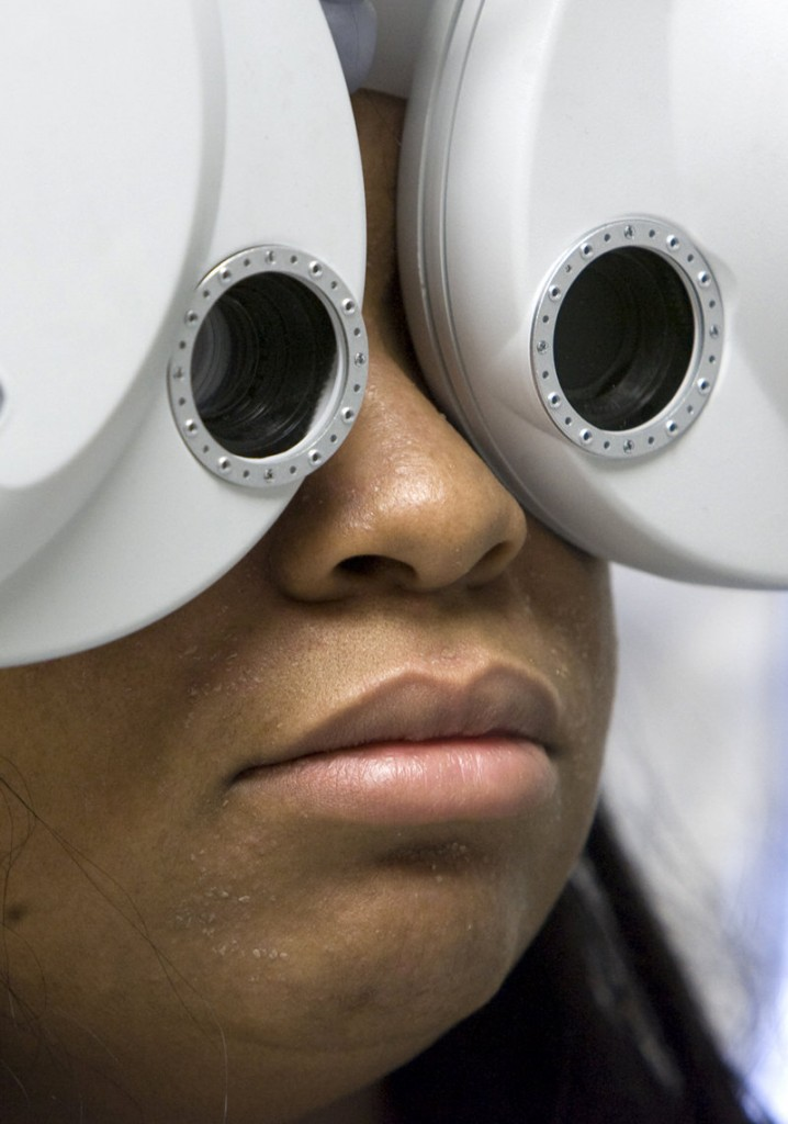 A Kansas City, Kan., woman undergoes a free eye exam on a visit to a mobile clinic May 11. Health plans offered under the Affordable Care Act will cover preventive care, such as flu shots and birth control, at no cost.