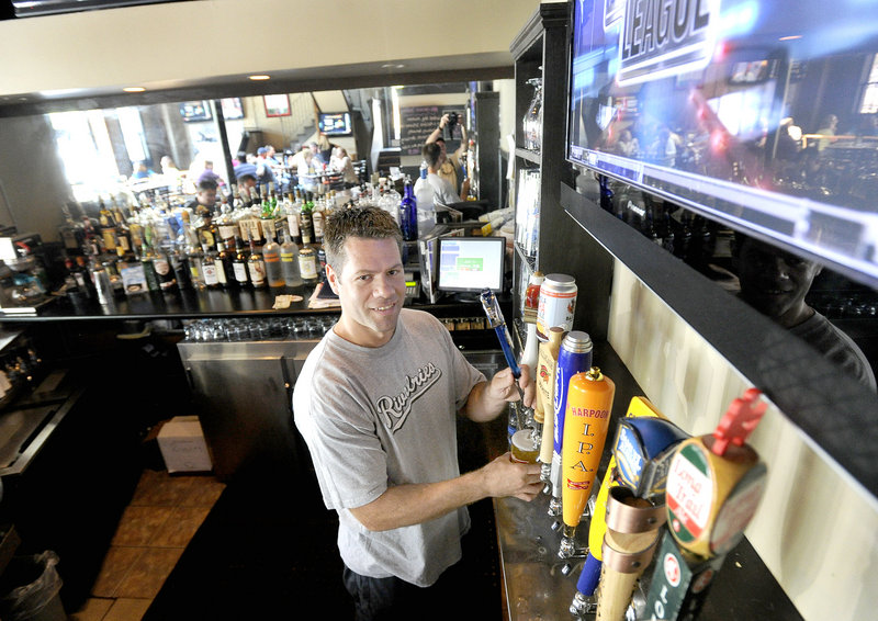 Owner Lance Meader pours a draft at Rivalries, a short walk from the Civic Center in Portland.